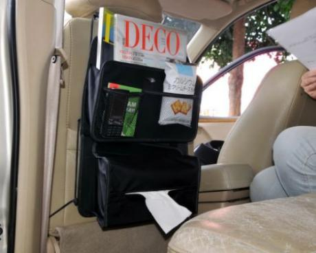 The back seat of tissue box, books and newspapers bags